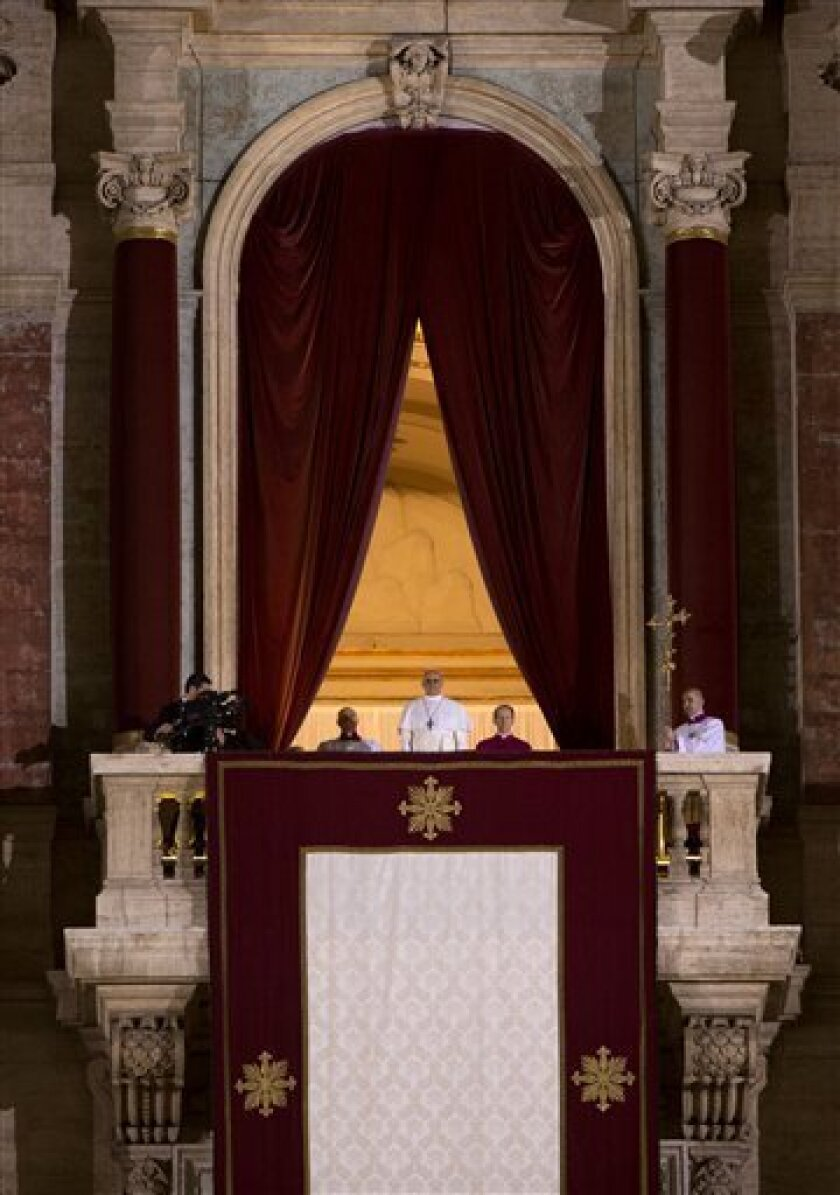 Pope Francis watches the crowd from the central balcony of St. Peter's Basilica at the Vatican, Wednesday, March 13, 2013. Argentine Cardinal Jorge Mario Bergoglio, who chose the name of Pope Francis, is the 266th pontiff of the Roman Catholic Church. (AP Photo/Oded Balilty)