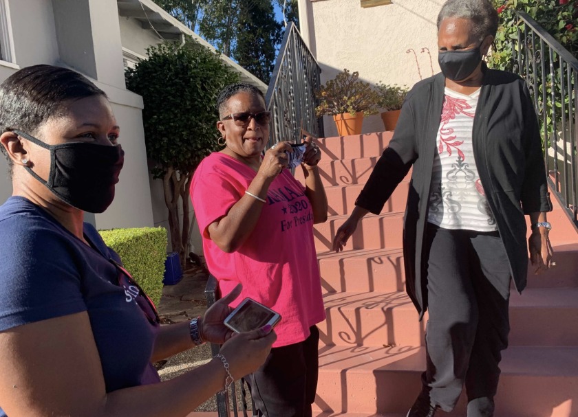 Saniyyah Smith, Sharon McGaffie and Judy Robinson stand on the steps of McGaffie's and Robinson's mother's home.