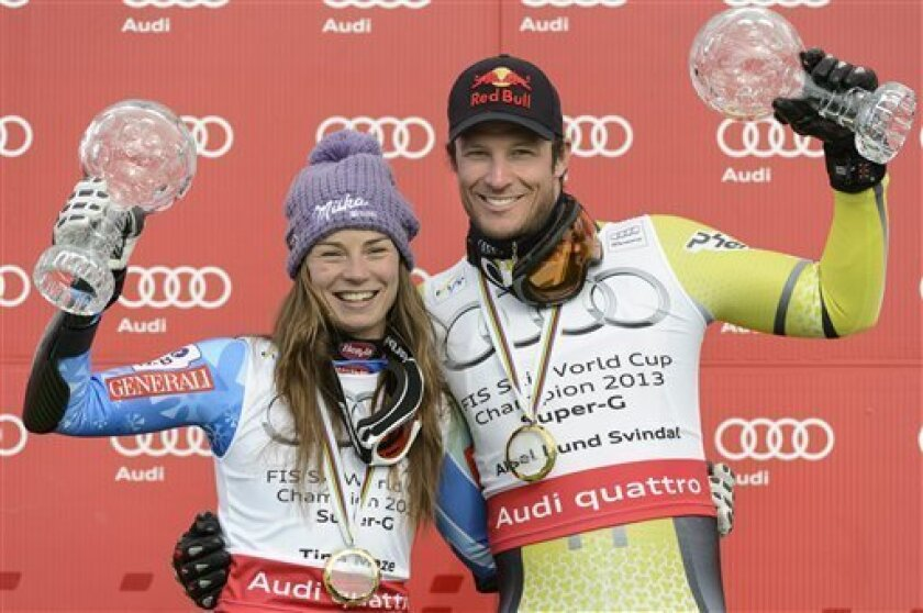 Slovenia's Tina Maze, left, and Norway's Aksel Lund Svindal pose with their trophies after winning the alpine skiing super-G overall World Cup in Lenzerheide, Switzerland,Thursday, March 14, 2013. (AP Photo/Keystone, Laurent Gillieron)