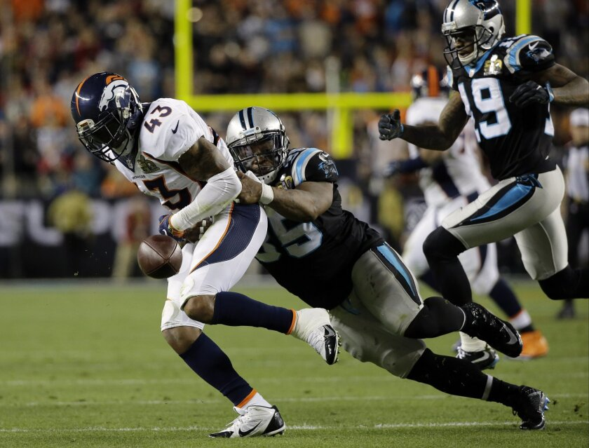 Denver Broncos' T.J. Ward (43) fumbles under pressure from Carolina Panthers' Mike Tolbert (35) during the second half of the NFL Super Bowl 50 football game Sunday, Feb. 7, 2016, in Santa Clara, Calif. (AP Photo/Ben Margot)