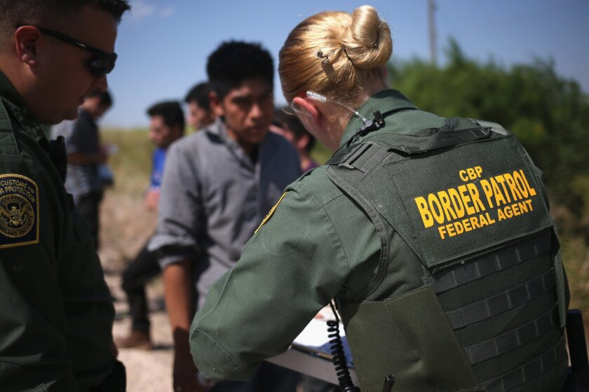U.S. Border Patrol agents detain immigrants caught crossing the border from Mexico into the United States in August near McAllen, Texas. A federal agency is recommending that border agents not wear body cameras.