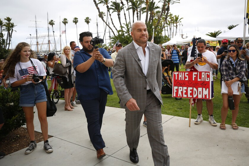Mixed martial arts fighter Tito Ortiz walks up to speak at a Recall Gavin Newsom rally