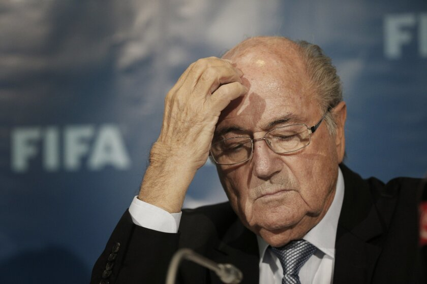 FILE - In this Dec. 19, 2014 file photo FIFA President Sepp Blatter gestures as he attends a news conference in Marrakech, Morocco. Sepp Blatter was back at FIFA headquarters  in Zurich for what could be the last time on Tuesday, Feb. 16, 2016 , challenging his eight-year ban for approving a $2 mil
