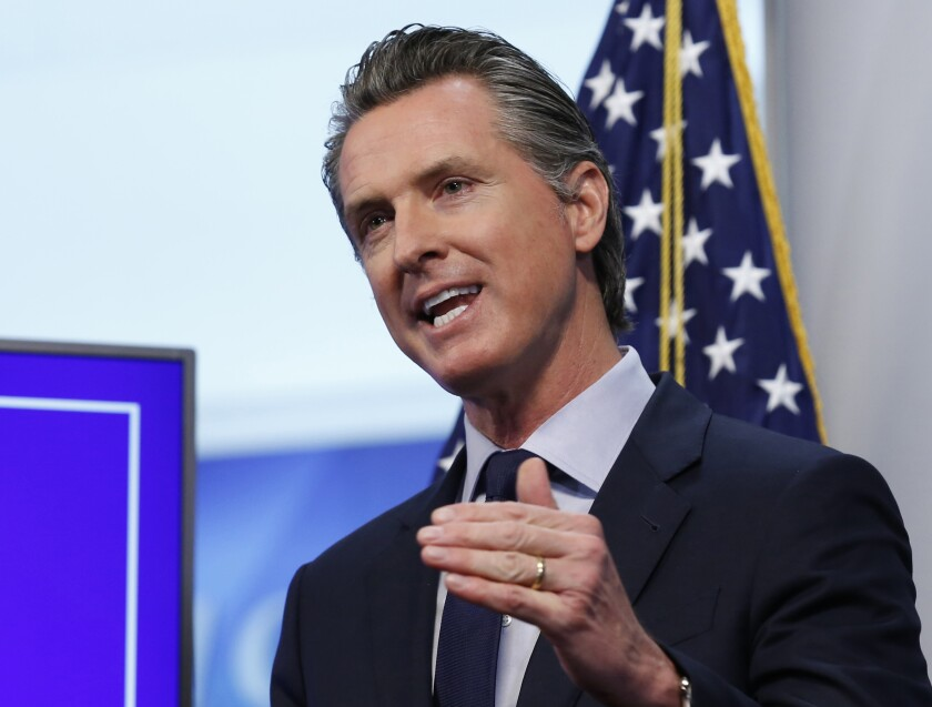 California Gov. Gavin Newsom speaks at a news conference.