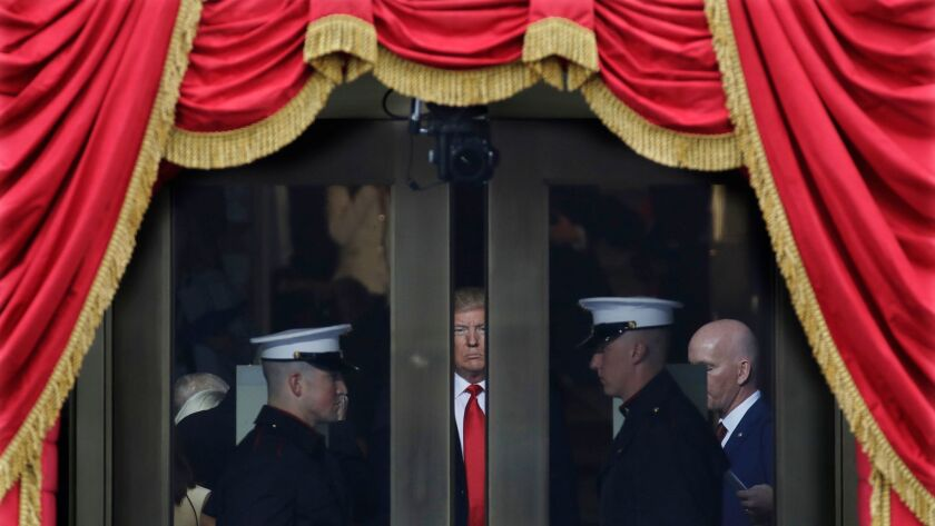 Donald Trump waits to step out onto the portico of the U.S. Capitol for his inauguration in January.
