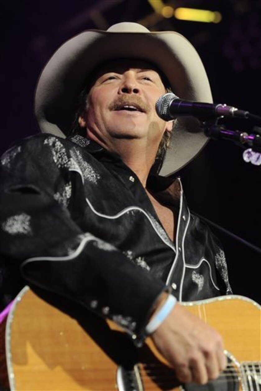 FILE - In this May 22, 2010 file photo, country singer Alan Jackson performs during a benefit show for the victims of the Upper Big Branch coal mine explosion at the Charleston Civic Center in Charleston, W.Va.  (AP Photo/Jeff Gentner, file)