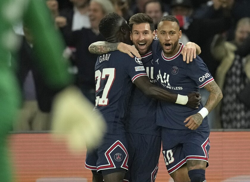 PSG's Lionel Messi, center, celebrates after scoring his side's second goal during the Champions League Group A soccer match between Paris Saint-Germain and Manchester City at the Parc des Princes in Paris, Tuesday, Sept. 28, 2021. (AP Photo/Christophe Ena)