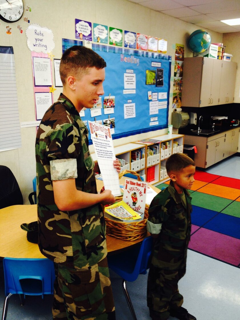 Eagle Young Marine Lance Cpl. Holtz and Eagle Young Marine Pvt. Molamphy  talk about the importance of being drug free to students at Mary Fay Pendleton school.