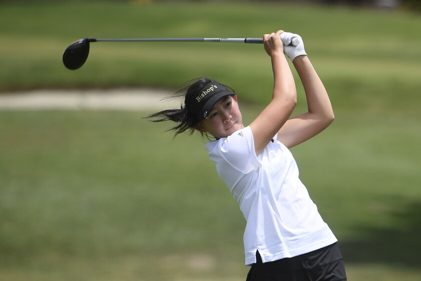 Lucy Yuan of The Bishop's School in La Jolla hits her tee shot on the 18th hole during the CIF girls golf finals.
