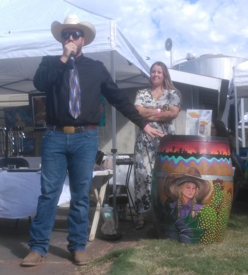 Copy - Auctioneer Timothy Georgeson and Marie Bravo.jpg