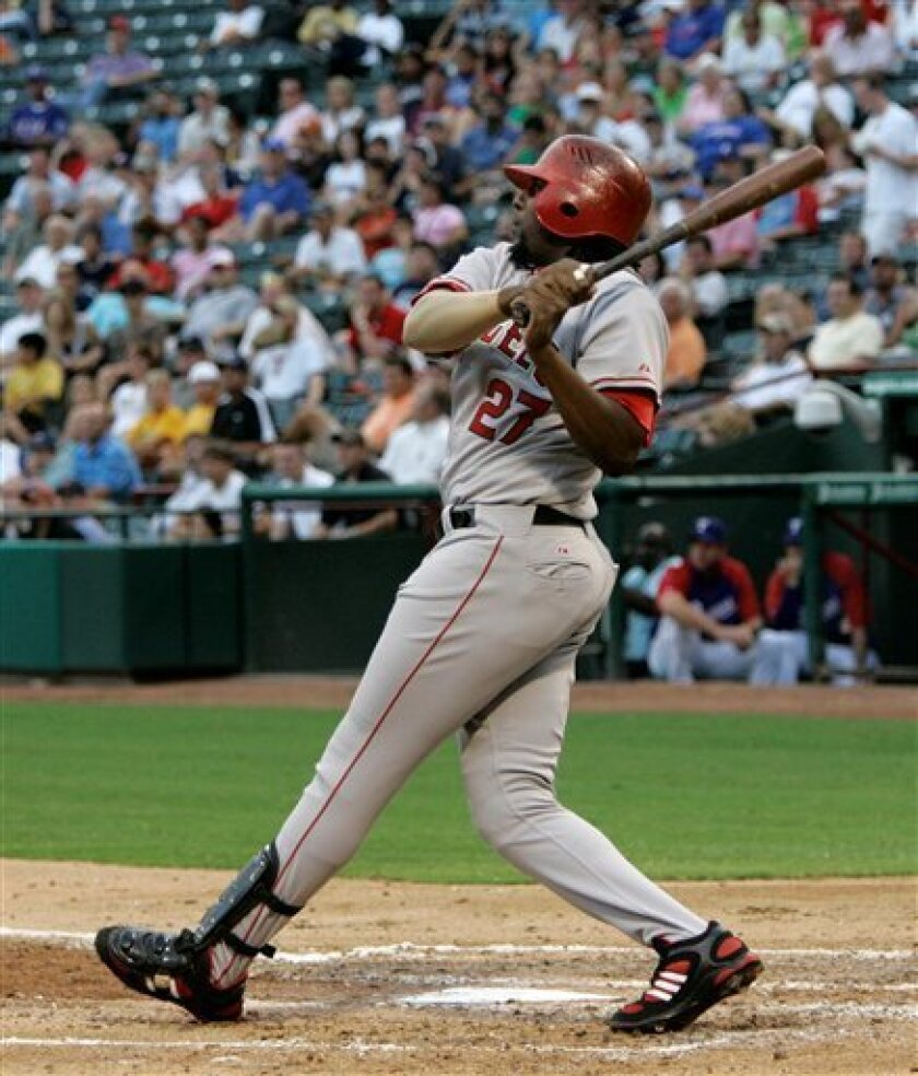 Los Angeles Angels' Vladimir Guerrero follows through on his two-run home run in the second inning off a pitch from Texas Rangers' Luis Mendoza during a Major League Baseball game, Monday, July 7, 2008, in Arlington, Texas. (AP Photo/Tony Gutierrez)