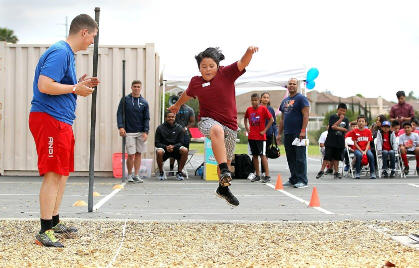 Steven Miramontes leaps in the long jump at Greg Rogers School during the Special Olympics unified games last week. All students, regardless of abilities, participated in the athletic competition.