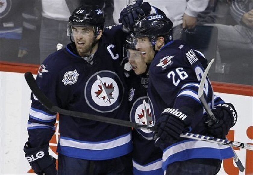 Winnipeg Jets' Andrew Ladd (16), Bryan Little and Blake Wheeler (26) celebrate after Little scored on Toronto Maple Leafs goaltender Jonas Gustavsson during the second period of an NHL hockey game in Winnipeg, Manitoba, Tuesday, Feb. 7, 2012. (AP Photo/The Canadian Press, Trevor Hagan)