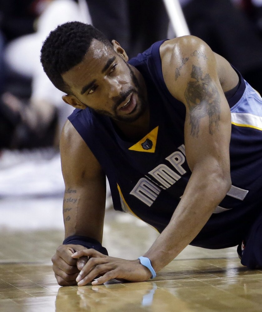 Memphis Grizzlies guard Mike Conley looks back towards his bench from the floor after a collision during the second half of Game 3 of a first-round NBA basketball playoff series against the Portland Trail Blazers in Portland, Ore., Saturday, April 25, 2015. Conley left the game and did not return.