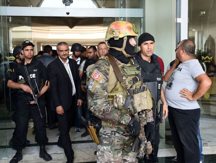 Tunisian security forces stand in front of the Imperial hotel in the resort town of Sousse, a popular tourist destination 90 miles south of the Tunisian capital on June 26.
