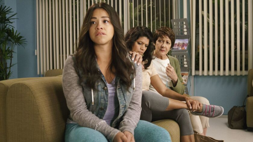 "Gina Rodriguez, left, as Jane, Andrea Navedo as Xo and Ivonne Coll as Alba in ""Jane the Virgin."""