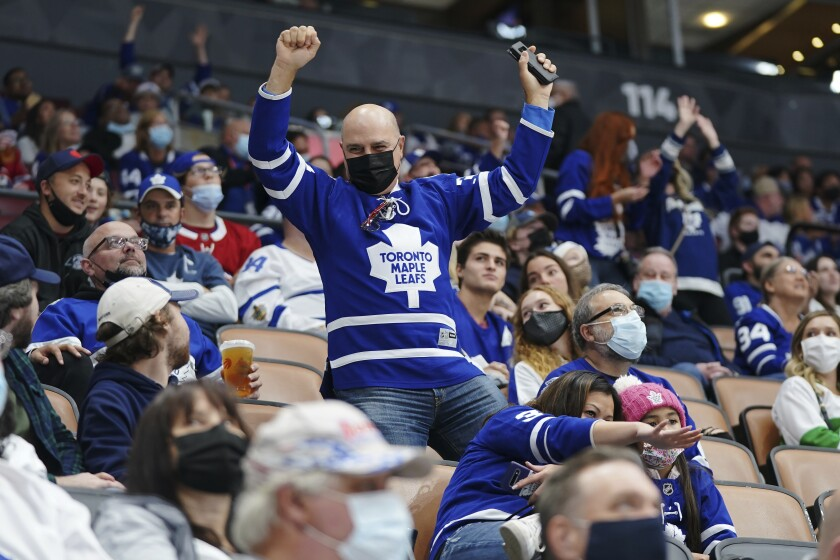 Fans dance during first period NHL pre-season hockey game between the Toronto Maple Leafs and Montreal Canadiens in Toronto. (Nathan Denette/The Canadian Press via AP)