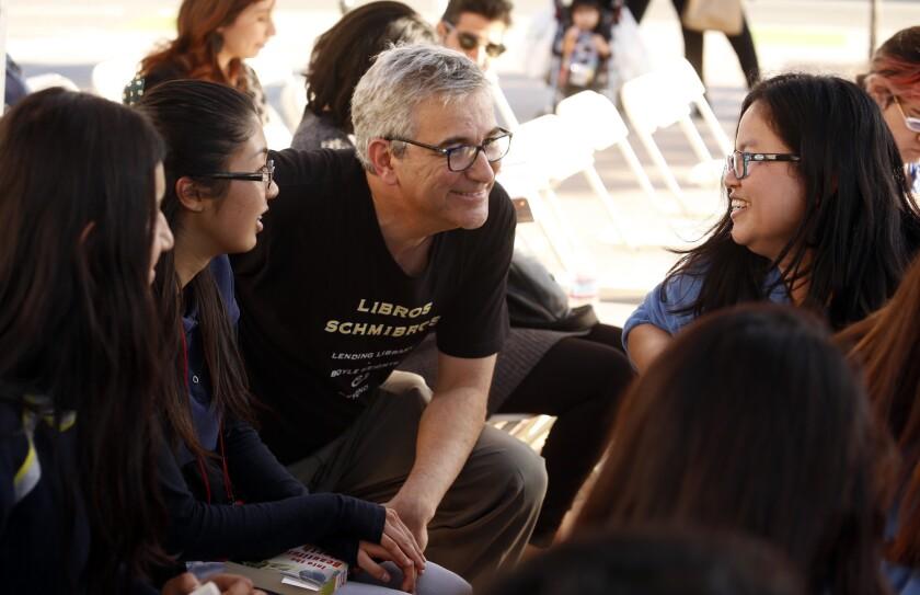 LOS ANGELES, CA - MARCH 25, 2015 -- David Kipen, co-director of Libros Schmibros, center, talks with