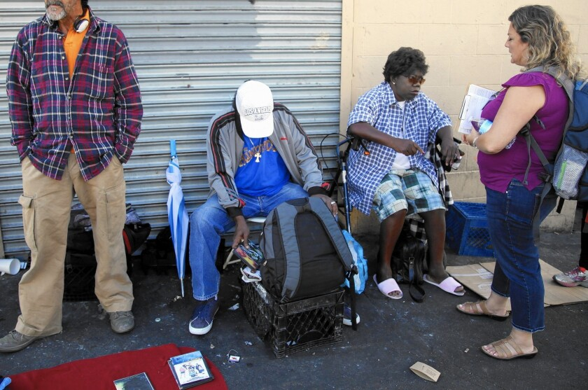 Dr. Susan Partovi, right, makes her rounds on skid row in downtown Los Angeles. She has worked in homeless medicine for 12 years.