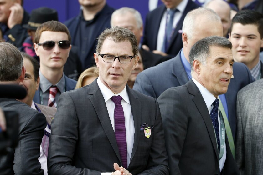 FILE - In this Oct. 30, 2015, file photo, chef Bobby Flay, center, attends the Breeders' Cup horse races at Keeneland race track in Lexington, Ky. Celebrity chef and prominent racehorse owner Bobby Flay has been named to the National Museum of Racing and Hall of Fame's board of trustees. The appointment was announced Monday, Nov. 23, 2015, by museum president Gretchen Jackson.(AP Photo/Brynn Anderson, File)