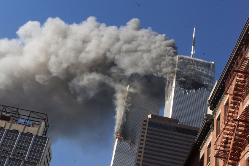 Smoke rising from the burning twin towers of the World Trade Center on 9/11.