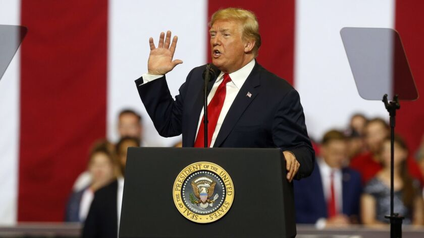 President Trump speaks at a campaign rally in Fargo, N.D.