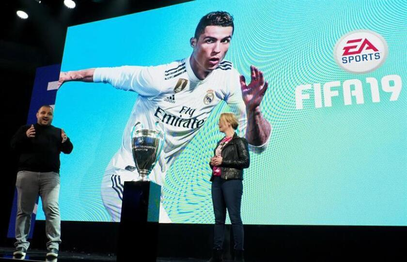 Game developers Aaron McHardy (L) and Lina Ingvarsdottir (R) stand by the UEFA Champions League trophy at the presentation for the upcoming FIFA19 soccer game at the Electronic Arts press conference at the Hollywood Palladium in Hollywood, California, USA, 09 June 2018. EFE/EPA
