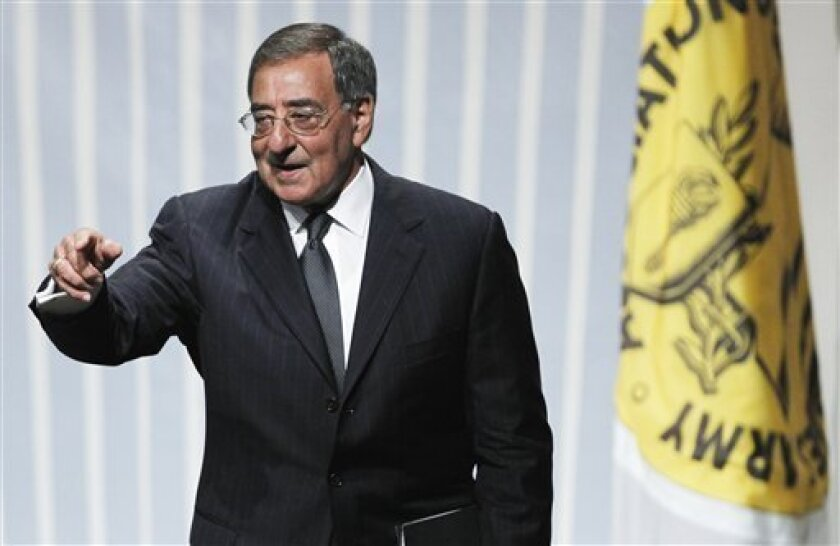 Defense Secretary Leon Panetta points to the crowd as he leaves after speaking to the Association of the U.S. Army in Washington, Wednesday, Oct. 12, 2011. (AP Photo/Manuel Balce Ceneta)