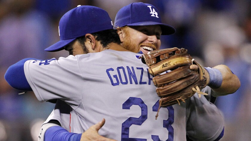 Dodgers first baseman Adrian Gonzalez, left, and third baseman Justin Turner congratulate one another following the team's 2-0 win over the Kansas City Royals on Tuesday.