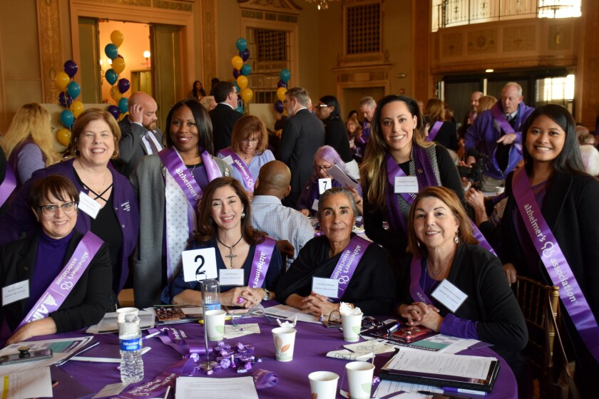 Alzheimer's Association San Diego/Imperial County chapter volunteers and employees pose for a photo during a luncheon.