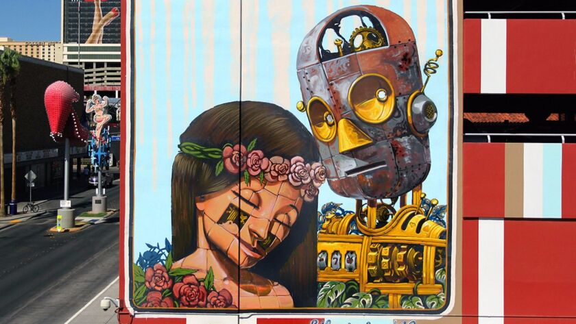 Pixel Pancho, a street artist from Turin, Italy, specializes in large wall murals, many of which feature a vintage robot. This work is at the corner of 7th and Fremont streets downtown.
