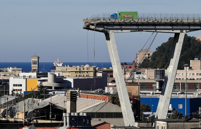 FILE - A Wednesday, Aug. 15, 2018 file photo showing a view of the Morandi highway bridge that collapsed in Genoa, northern Italy. Italy's government says it has scored a victory in a battle stemming from the deadly 2018 collapse of Genoa's bridge, with the Benetton fashion family agreeing to exit the holding company that manages and maintains most of Italy's toll roads and bridges. (AP Photo/Antonio Calanni, File)