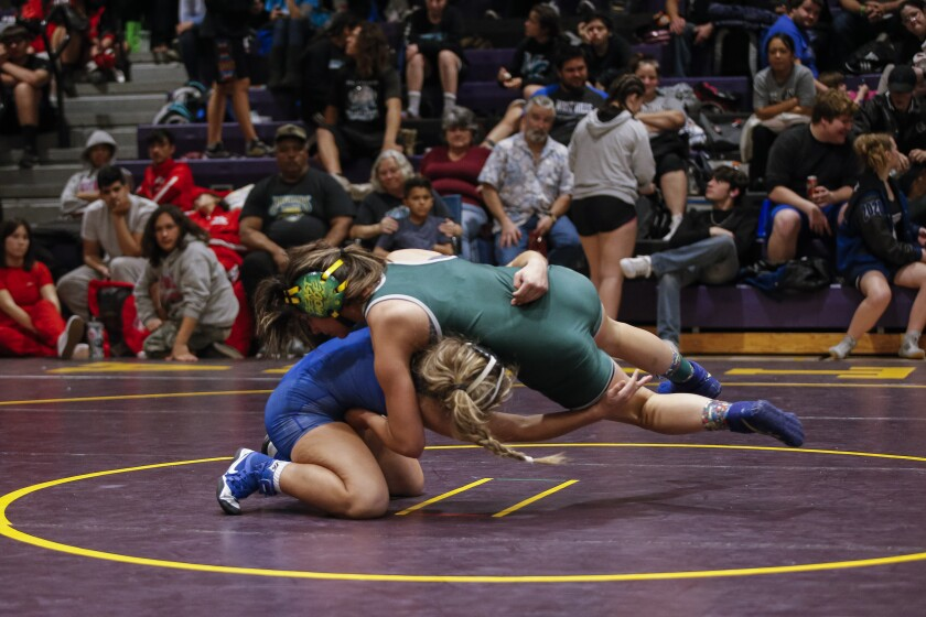 Hilltop's Nadia Barrientos (top) scores a 3-0 win over Madison's Amber Plasencia.