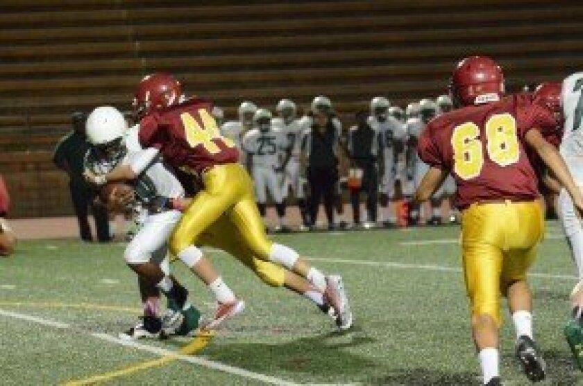 TPHS player Louis Bickett sacks the quarterback.