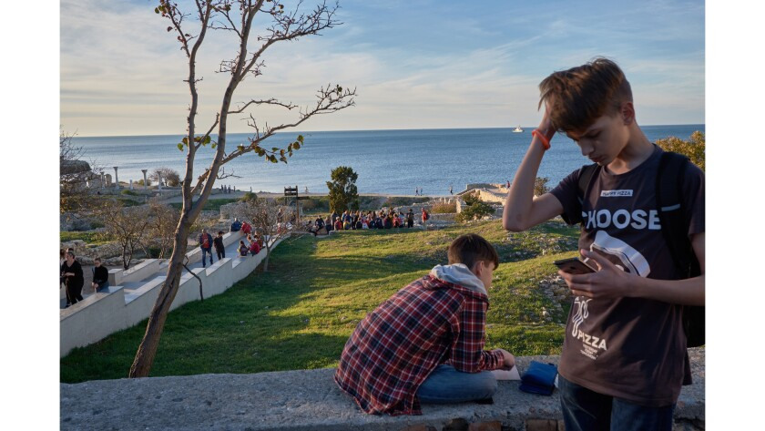 Students take notes while on a school trip to Khersones, a Greek archeological site in Crimea. Oct.