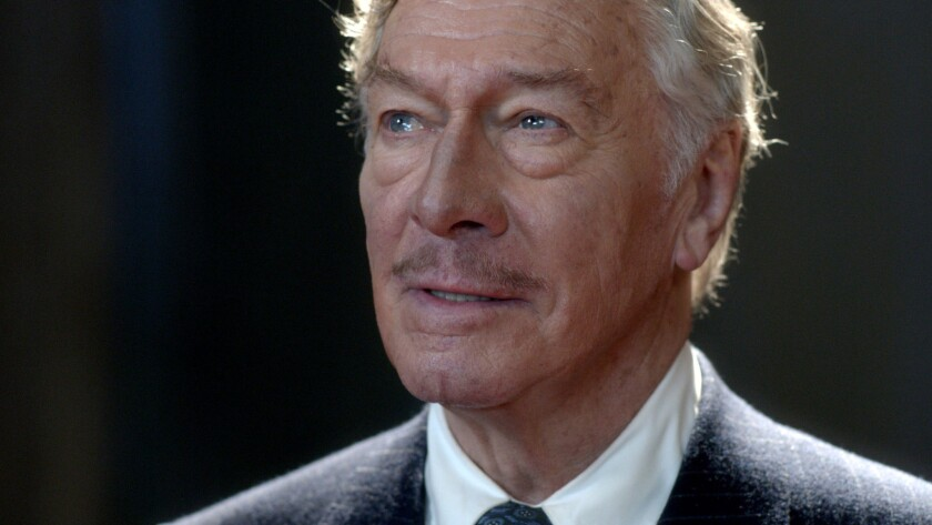 A headshot of Christopher Plummer in a suit and tie