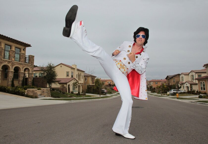 Ready-to-rock Chris Maddox unleashes an Elvis-style kick that's part of his performance fronting Graceband, a Presley tribute band that plays in San Diego, Orange and Los Angeles counties. Locally, the band has appeared at the Del Mar Fair and Belly-Up tavern.