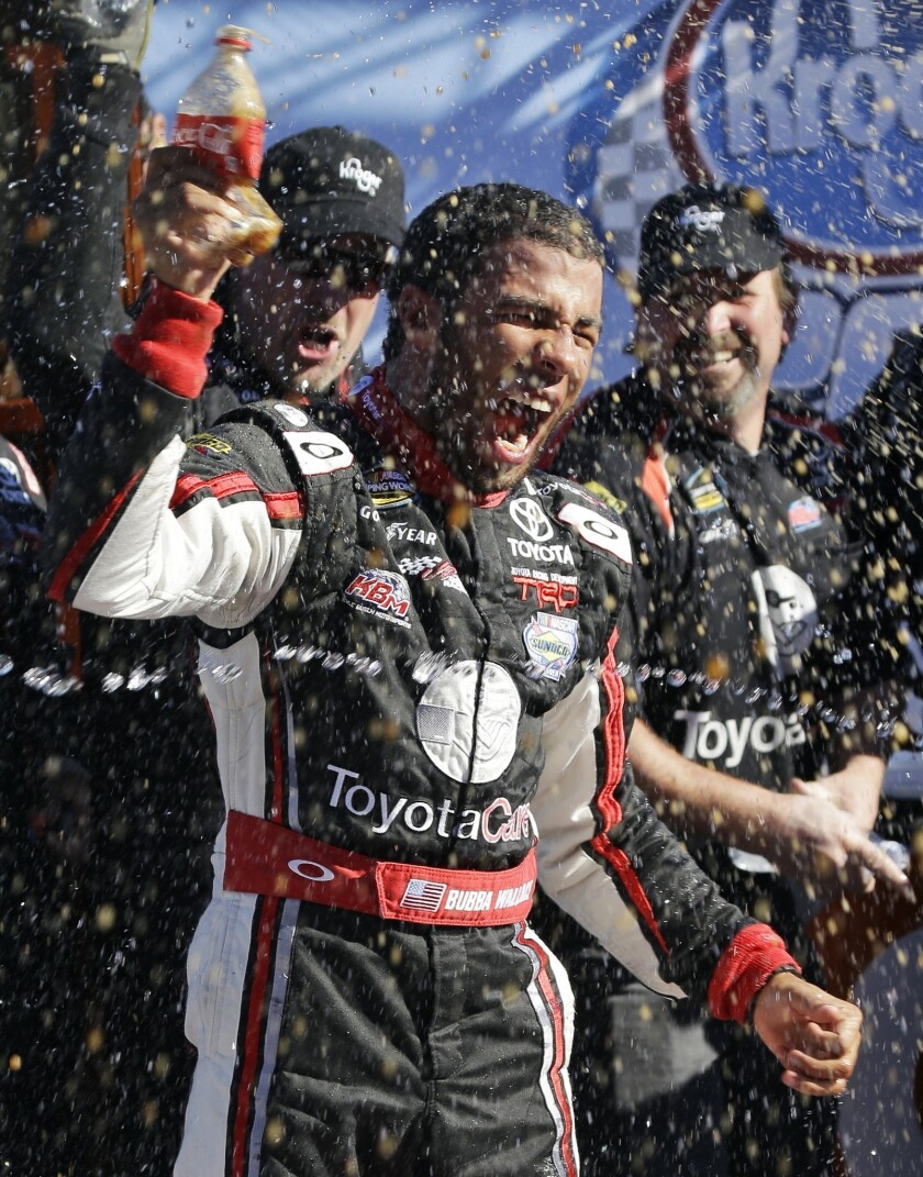 Darrell Wallace Jr. celebrates his NASCAR truck series win at Martinsville Speedway on Saturday.