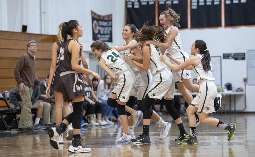 Sage Hill teammates mob Emily Elliott, center, after she hit a game winning shot with one second in