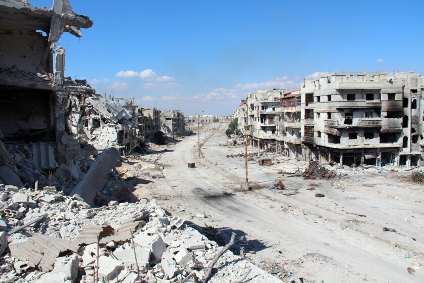 Hundreds of trapped Syrian civilians could leave the rebel-held center of Homs, pictured in September, in what appears to be the first solid accomplishment of the Geneva peace talks.