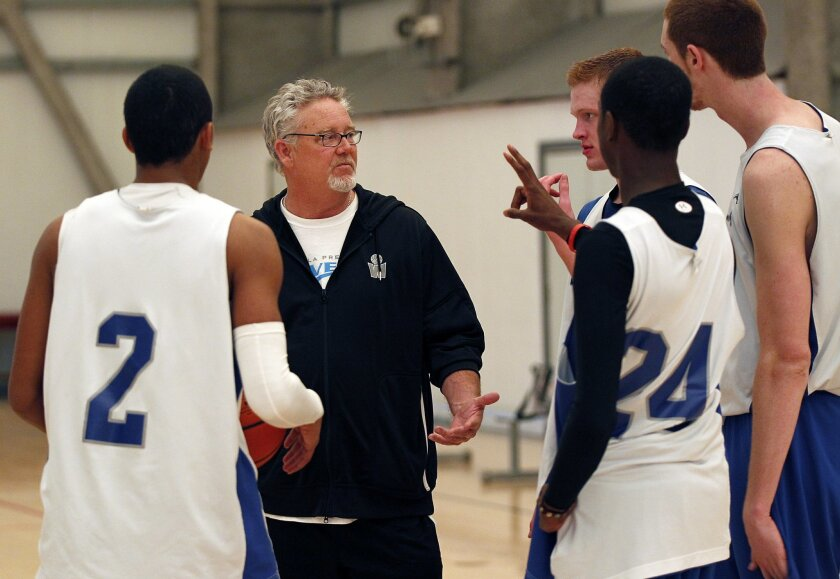 Coach Gary Trousdale, who built a powerful program at Westwind Prep in Phoenix, talks to his La Jolla Prep players. K.C. Alfred • u-t photos