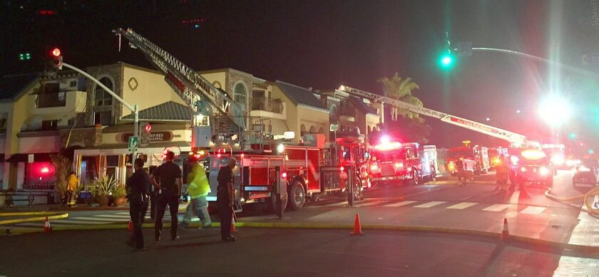 Nearly a dozen fire engines and ambulances are sent to the Sammy's Woodfired Pizza fire with most of them parking along and closing down several blocks of Pearl Street for more than four hours on the night of Sept. 5, 2015.