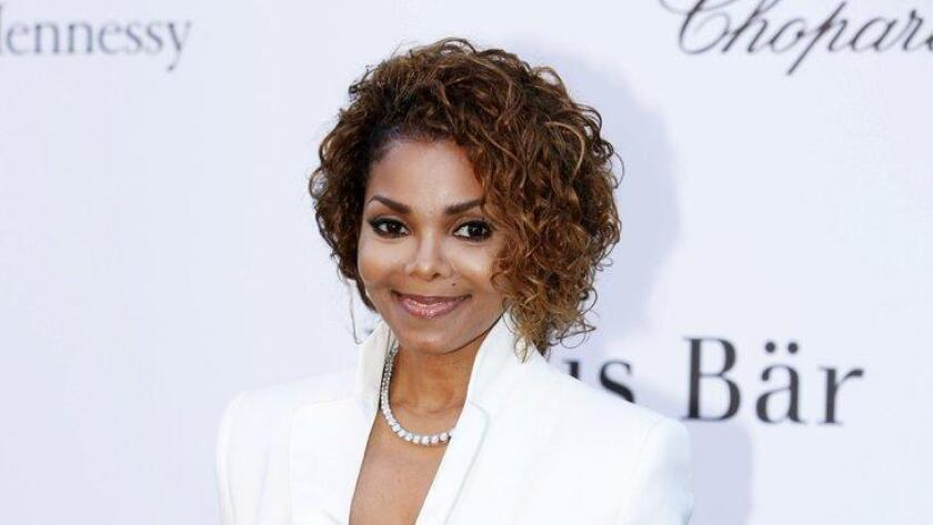 FILE - In this May 23, 2013 file photo, singer Janet Jackson arrives at amfAR Cinema Against AIDS benefit at the Hotel du Cap-Eden-Roc, during the 66th international film festival, in Cap d'Antibes, southern France. Janet Jackson is releasing her first album in seven years this fall. The pop icon said on her website Wednesday, June 3, 2015, that the album, not yet titled, will be released on her own label, Rhythm Nation Records, via Bertelsmann Music Group. (Photo by Joel Ryan/Invision/AP, File) (/ The Associated Press)