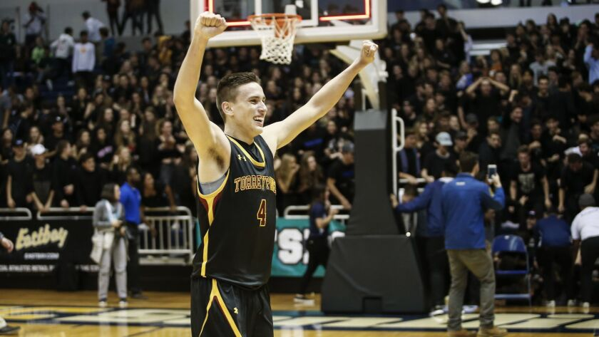 Torrey Pines' Bryce Pope (4) raises his arms after the Falcons beat Foothills Christian in the Open Division final.