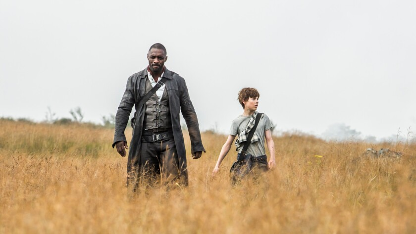 "Idris Elba, left, and Tom Taylor in ""The Dark Tower."""