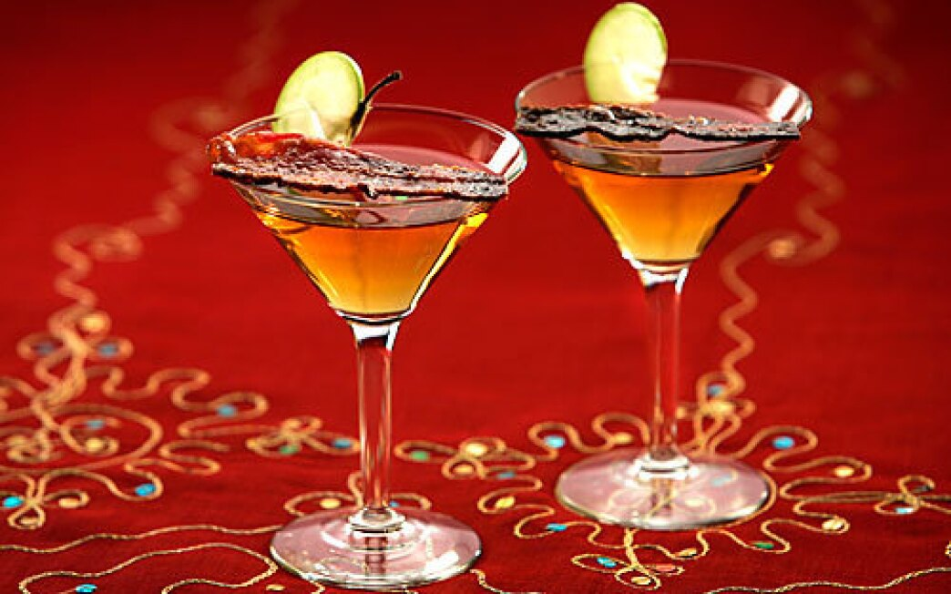 Candied bacon martinis are made with vodka, Applejack brandy, amaretto and maple syrup. And candied bacon, of course.