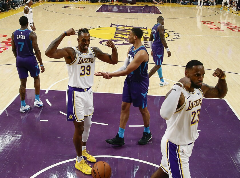 Lakers center Dwight Howard, left, and teammate LeBron James flex after a second-half basket.
