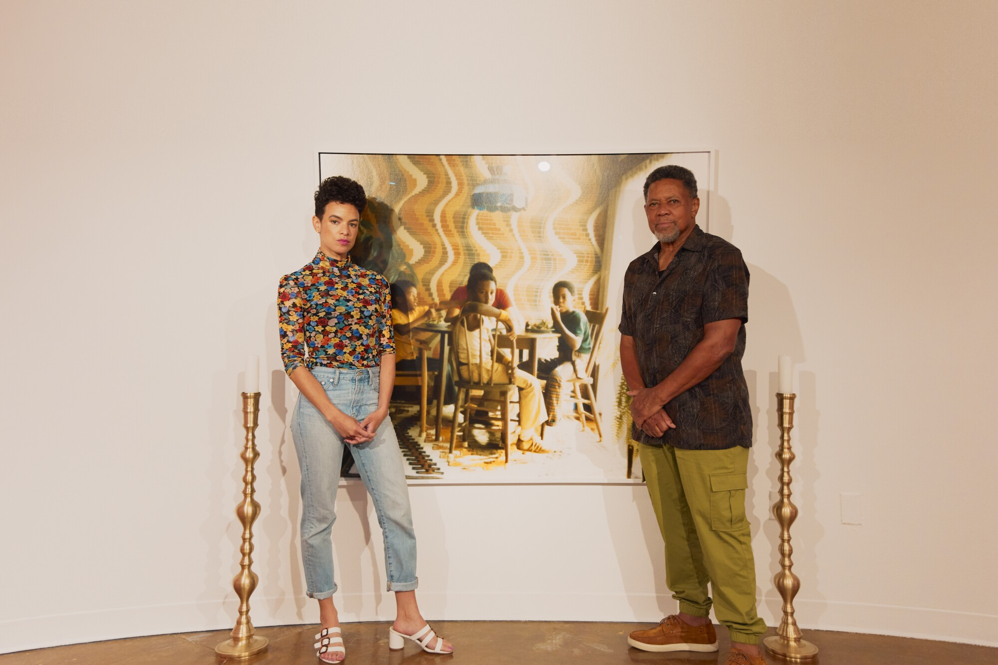 Artist Sadie Barnette and her father, Rodney, at her show: Legacy and Legend at Pitzer College Art Galleries.