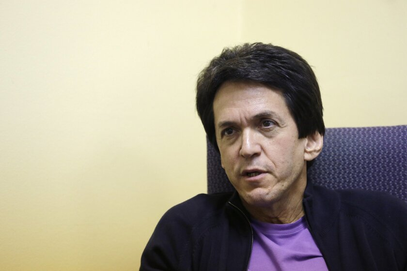 In this Nov. 7, 2013 file photo, author Mitch Albom is interviewed in Highland Park, Mich. about his drive to rebuild 10 libraries in a central Philippine city ravaged by Typhoon Haiyan in November. He pledged to raise $160,000, starting with his own contribution of $10,000 for the libraries.  Albo
