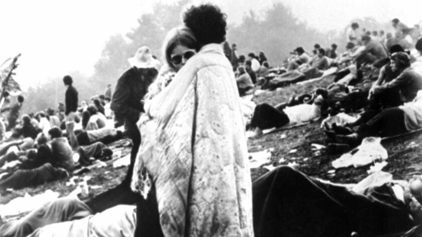 This image at the Woodstock festival in 1969 was featured in magazines, on posters and on the cover of the Woodstock concert album.